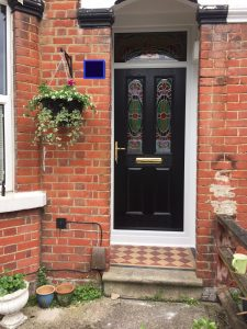 Black two panel composite glass with bespoke glass design