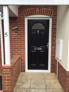 black 4 panel 1 arch composite door