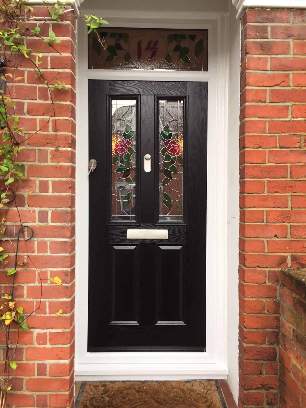 Black Composite Front Door 2 Panel 2 Square with bespoke Roses and number 14 glass option installed by Buildmydoor