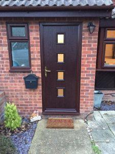 Composite front door in brown