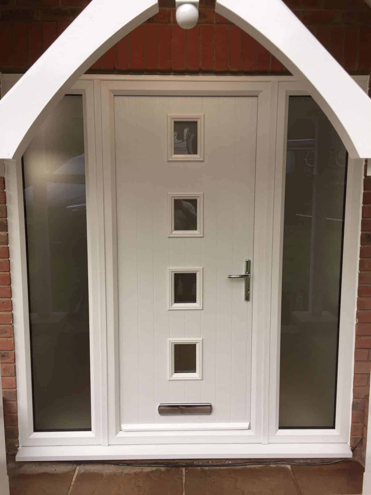 White Composite Front Door 4 Square with side panels in an arched way porch installed by Buildmydoor